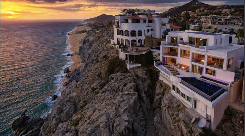 """<p>Dramatic views of the Pacific are just the beginning of an unforgettable vacation at Villa Lands End. This state-of-the-art home sits 260 feet above the ocean to earn its panoramic views and offer ample indoor-outdoor entertaining spaces. An infinity pool, oversize hot tub, multiple terraces, gourmet kitchen, fitness room, and seven beautiful bedrooms offer the perfect respite to enjoy with family or a few of your closest friends this summer. You're also just minutes from all the action of downtown Cabo.</p><p><a class=""""link rapid-noclick-resp"""" href=""""https://www.onefinestay.com/home-listing/TK995/"""" rel=""""nofollow noopener"""" target=""""_blank"""" data-ylk=""""slk:Book Now"""">Book Now</a></p>"""