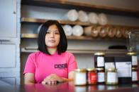 Mandy Yin poses inside Nasi Economy Rice, the takeaway shop she owns, amid the coronavirus disease (COVID-19) outbreak, in North London