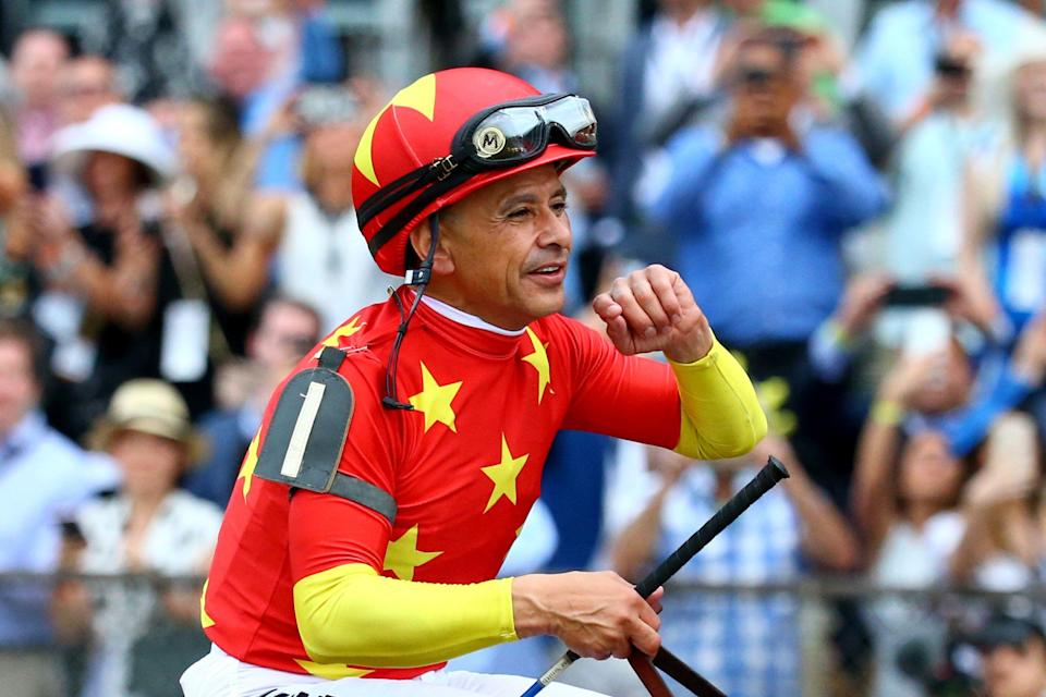 ELMONT, NY - JUNE 09:  Jockey Mike Smith celebrates atop of Justify #1 during the 150th running of the Belmont Stakes at Belmont Park on June 9, 2018 in Elmont, New York. Justify becomes the thirteenth Triple Crown winner and the first since American Pharoah in 2015.  (Photo by Mike Stobe/Getty Images)