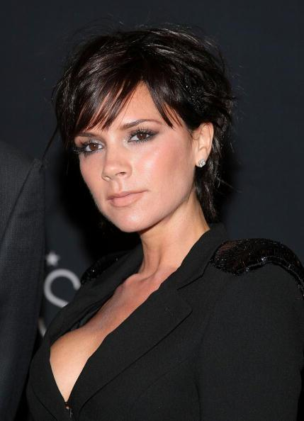 <p>Victoria Beckham has had many a pixie cut in her time. From the questionable highlighted blonde crop back in the noughties to this chic brunette look in 2009. <i>[Photo: Getty]</i></p>
