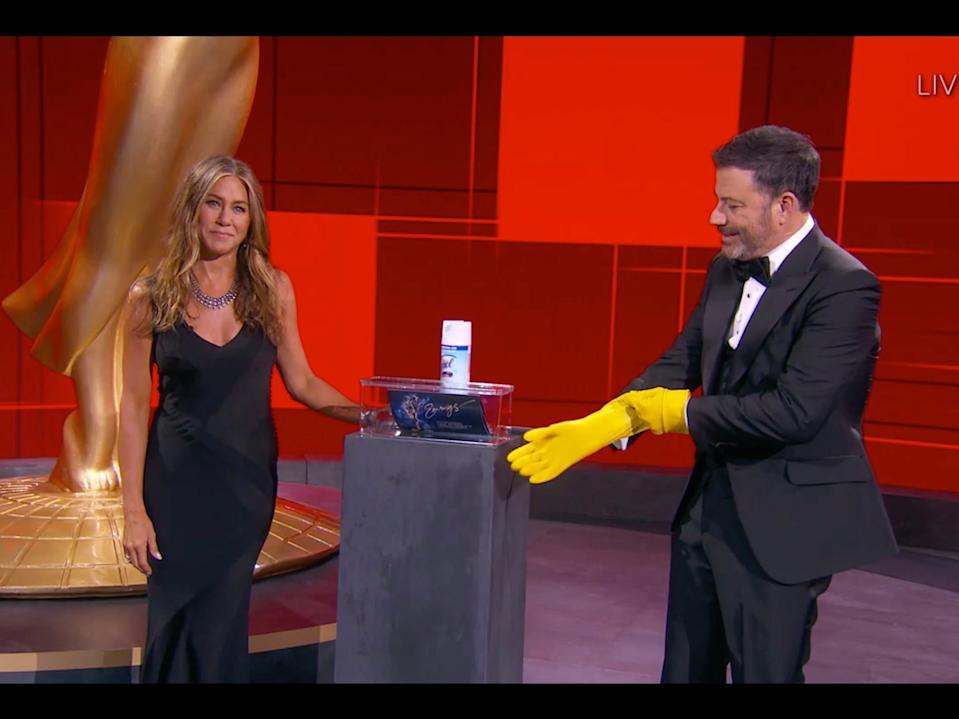 Jennifer Aniston presenting the award for outstanding lead actress in a comedy series alongside host Jimmy Kimmel.