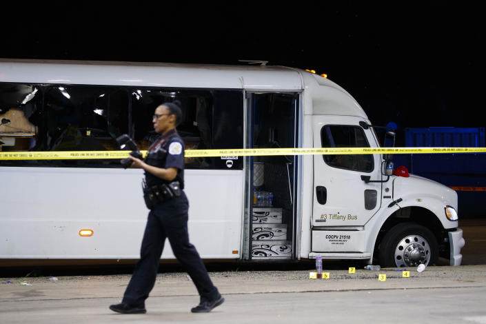 Chicago police officers work at the scene where at least eight people were wounded in a shooting involving a party bus in the 1600 block of North LaSalle Drive in the Old Town Triangle neighborhood Thursday July 22, 2021 in Chicago.(Armando L. Sanchez /Chicago Tribune via AP)