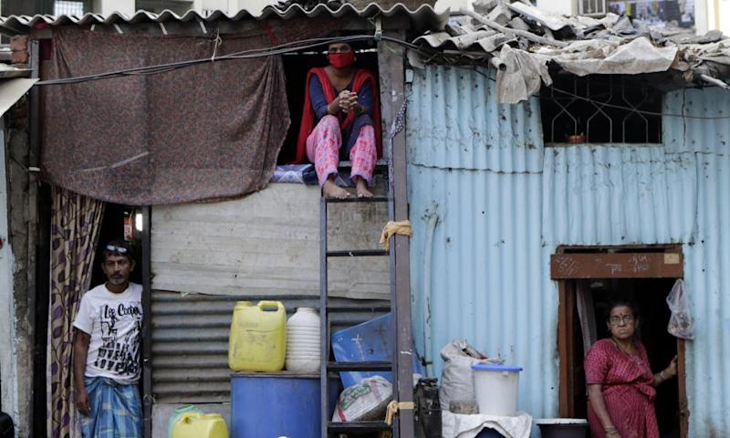 People in their shanties at Dharavi during the coronavirus lockdown in Mumbai