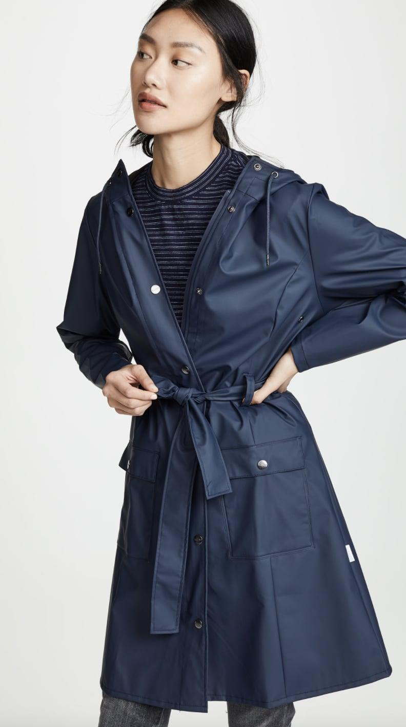 <p>We're loving the deep blue shade of this <span>Rains Curve Jacket</span> ($135).</p>