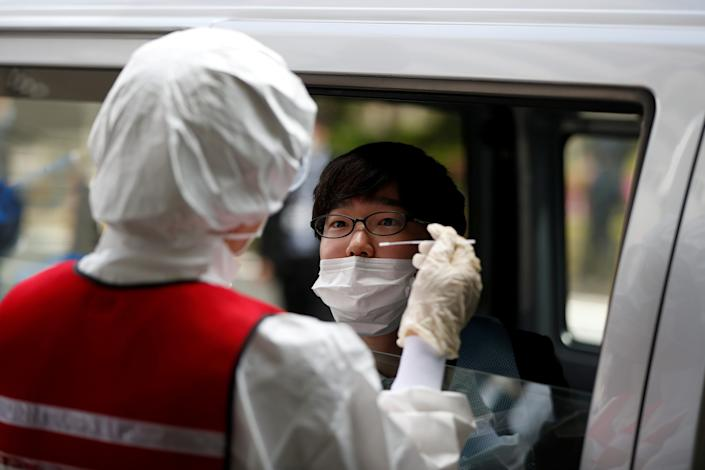 FILE PHOTO: A medical worker conducts a simulation for drive-through polymerase chain reaction (PCR) tests for the coronavirus disease (COVID-19) at Edogawa ward in Tokyo, Japan April 22, 2020.  REUTERS/Issei Kato