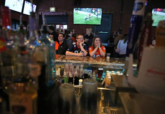Denver Broncos fans watch their team plays the Seattle Seahawks during the second half of the Super Bowl, inside Jackson's, a sports bar and grill in Denver, Sunday, Feb. 2, 2014. The Seahawks won 43-8. (AP Photo/Brennan Linsley)