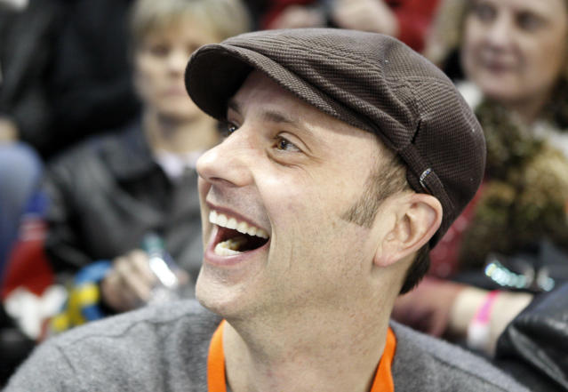"FILE - In this Jan. 15, 2010 file photo, former Olympian Brian Boitano smiles in the stands during the men's singles competition at the U.S. figure skating championships in Spokane, Wash. Two days after being named to the U.S. delegation for Sochi, Boitano has announced he is gay. But the 1988 gold medalist says Thursday, Dec. 19, 2013, in a statement that ""being gay is just one part of who I am. ... I hope we can remain focused on the Olympic spirit which celebrates achievement in sport by peoples of all nations."" (AP Photo/Rick Bowmer, File)"
