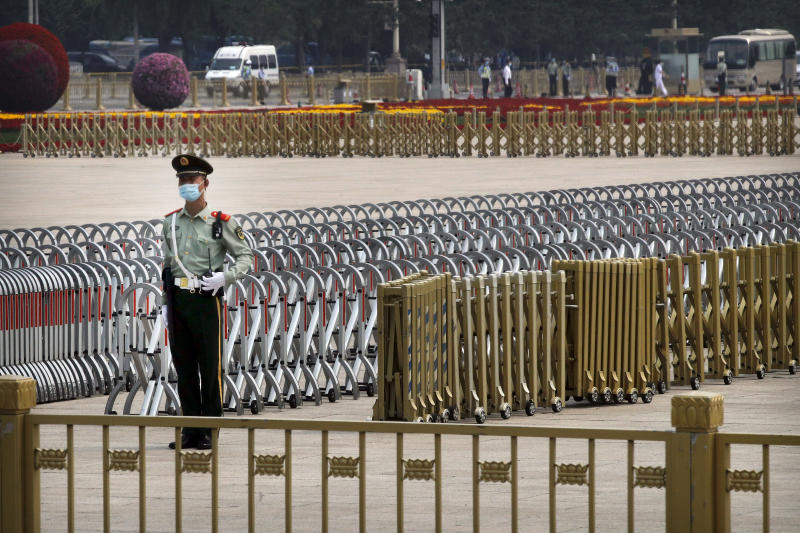A Chinese paramilitary policeman wearing a face mask to protect against the new coronavirus stands guard on Tiananmen Square before the opening session of the Chinese People's Political Consultative Conference (CPPCC) in Beijing, Thursday, May 21, 2020. (AP Photo/Andy Wong, Pool)