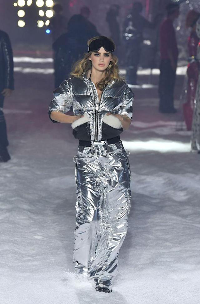 <p>Model wears a silver foil metallic puffer jacket and pants at the Philipp Plein FW18 show. (Photo: Getty) </p>