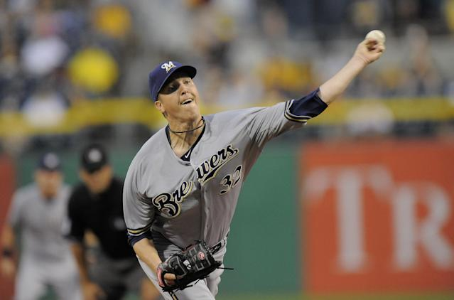Milwaukee Brewers starting pitcher Tom Gorzelanny (32) delivers a pitch during the first inning of a baseball game against the Pittsburgh Pirates on Wednesday, Aug. 28, 2013, in Pittsburgh. (AP Photo/Don Wright)