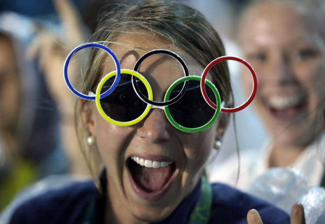 <p>Jackie Briggs from the United States wears the Olympic ring sunglasses during the closing ceremony in the Maracana stadium at the 2016 Summer Olympics in Rio de Janeiro, Brazil, Sunday, Aug. 21, 2016. (AP Photo/David Goldman) </p>