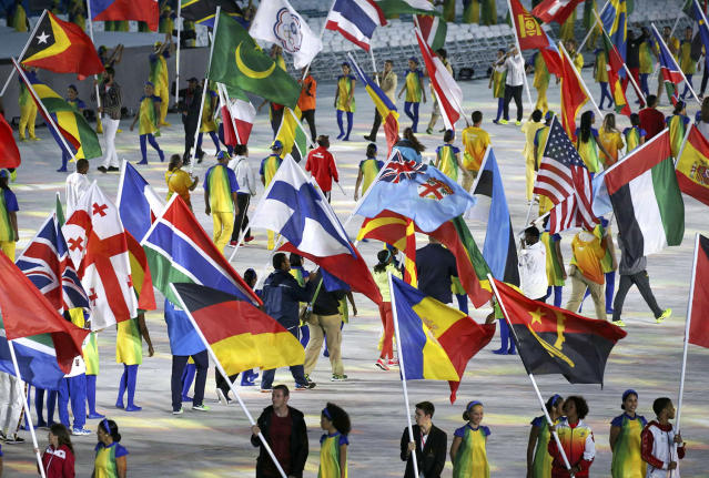 <p>Olympic athletes enter onto the stage during the closing ceremony for the 2016 Rio Olympics on August 21, 2016. (REUTERS/Kevin Lamarque) </p>