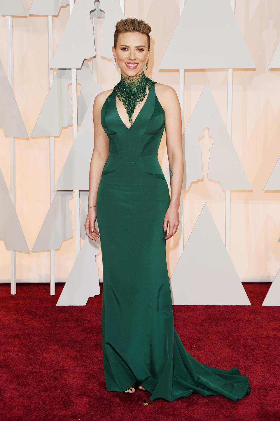 In 2015, ScarJo hit the Oscars red carpet in this slinky Versace number and supersized necklace. She finished the look with a slicked back hairdo and bright lippy. Needless to say, the outfit was a hit.