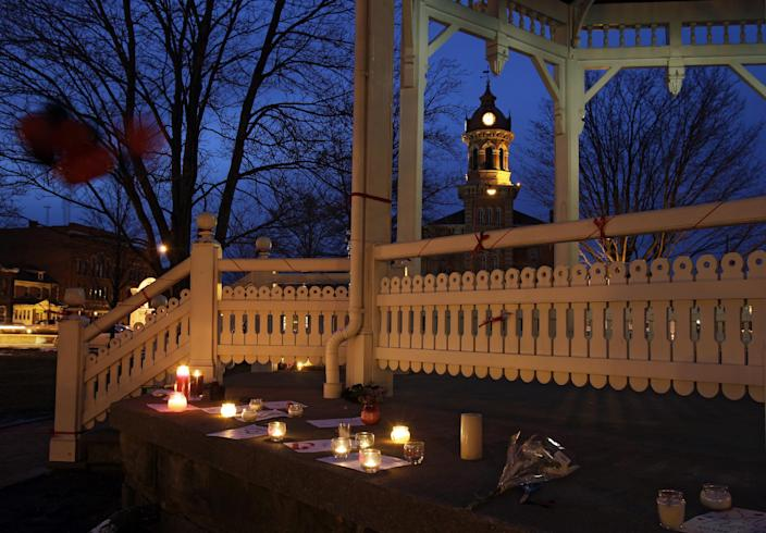 Candles flicker at a makeshift memorial at the gazebo in Chardon, Ohio Tuesday evening, Feb. 28, 2012 . The Geauga County town 30 miles east of Cleveland is mourning the death of three students and the wounding of two others in a shooting at the high school Monday morning. (AP Photo/Mark Duncan)