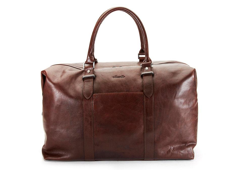 """<p>Kenneth Cole Smooth Leather Duffle Bag, $425, <a href=""""http://www.kennethcole.com/product/index.jsp?productId=42503856&cp=24307366.13219161.13225455.3075281"""" rel=""""nofollow noopener"""" target=""""_blank"""" data-ylk=""""slk:kennethcole.com"""" class=""""link rapid-noclick-resp"""">kennethcole.com</a></p>"""