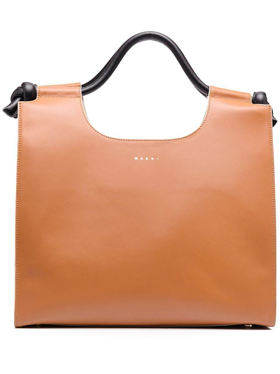 """<p><strong>Marni</strong></p><p>farfetch.com</p><p><strong>$2090.00</strong></p><p><a href=""""https://go.redirectingat.com?id=74968X1596630&url=https%3A%2F%2Fwww.farfetch.com%2Fshopping%2Fwomen%2Fmarni-logo-print-leather-tote-bag-item-16085335.aspx&sref=https%3A%2F%2Fwww.harpersbazaar.com%2Ffashion%2Ftrends%2Fg22591832%2Fbest-laptop-bags-for-women%2F"""" rel=""""nofollow noopener"""" target=""""_blank"""" data-ylk=""""slk:Shop Now"""" class=""""link rapid-noclick-resp"""">Shop Now</a></p><p>A sleek bag that will fit anything and everything, whether you are going to the office or hitting the road. </p>"""