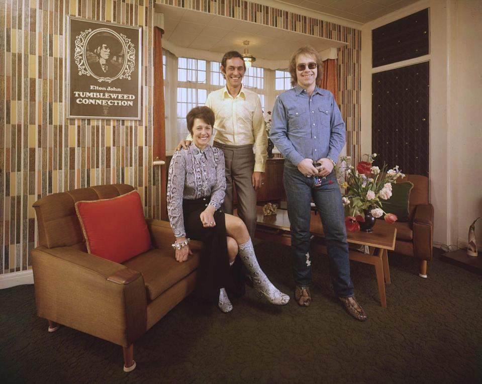 <p>Elton John with his mother, Sheila Eileen Dwight, and stepfather, Fred Fairebrother, at their apartment in London in 1971.</p>