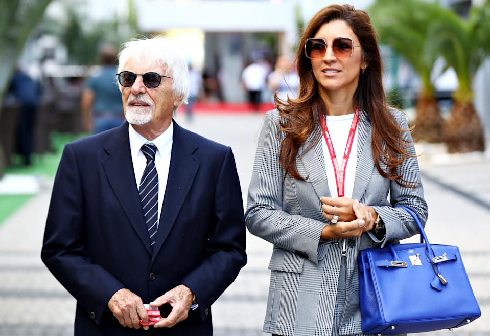 Bernie Ecclestone, Chairman Emeritus of the Formula One Group, and his wife Fabiana walk in the Paddock before the F1 Grand Prix of Russia at Sochi Autodrom on September 29, 2019 in Sochi, Russia. (Photo by Mark Thompson/Getty Images)