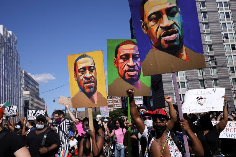 FILE PHOTO: Demonstrators protest in the aftermath of the death in Minneapolis police custody of George Floyd
