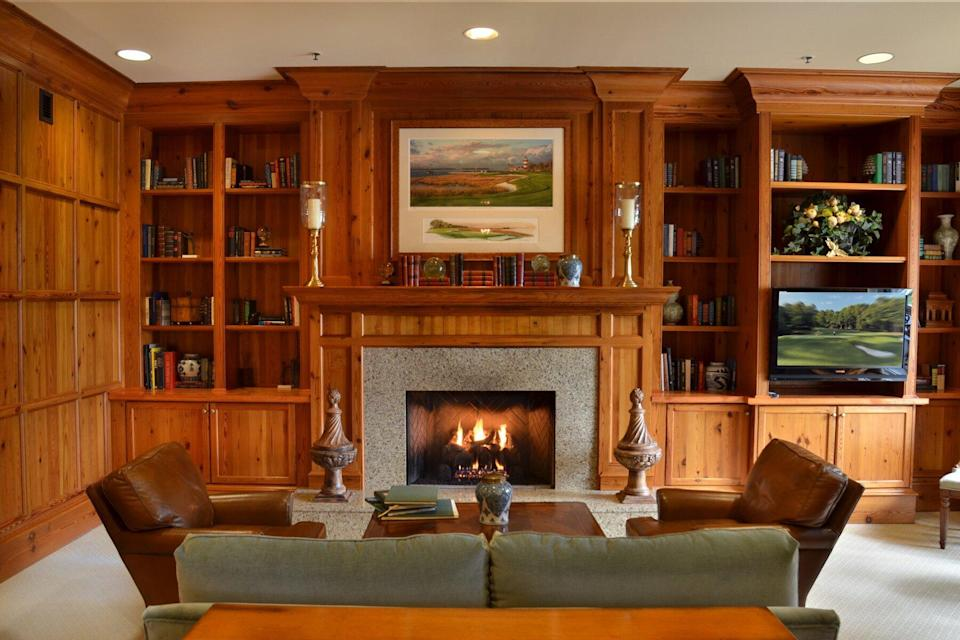 The Inn & Club at Harbour Town library with fireplace