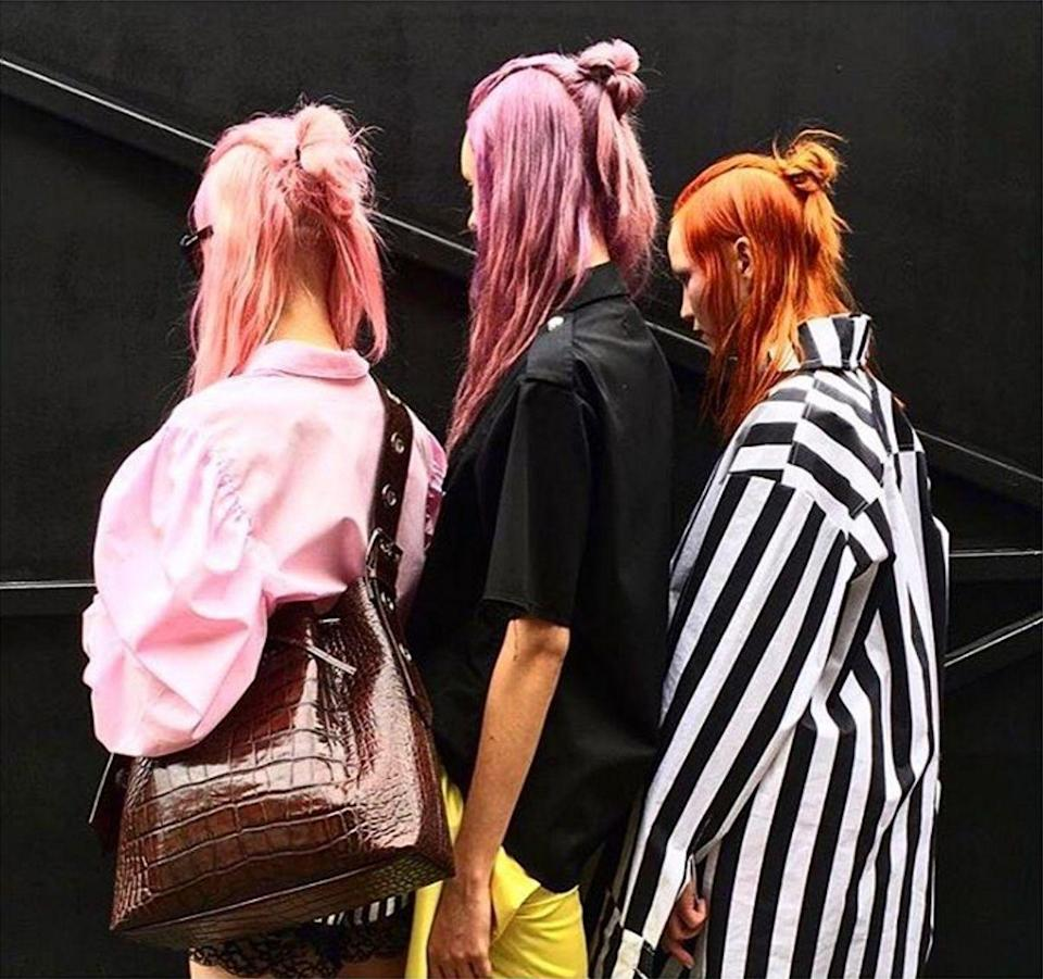 """<p><strong>The Multi-coloured Hun (half-bun)</strong></p><p>Our favourite hair look at the SS17 shows had to be the multi-coloured locks at Marques' Almeida on the last day of LFW, created by super stylist <a href=""""https://www.instagram.com/duffy_duffy/?hl=en"""" rel=""""nofollow noopener"""" target=""""_blank"""" data-ylk=""""slk:Duffy"""" class=""""link rapid-noclick-resp"""">Duffy</a>. Even if you don't have the vivd peach or pink hair yourself, these half-up, half-down scruffy buns are the epitome of undone elegance.</p><span class=""""copyright"""">Photo: via @duffy_duffy.</span>"""