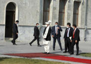 Afghan President Ashraf Ghani, center, waits to welcome visiting Pakistan Prime Minister Imran Khan at the Presidential Palace in Kabul, Afghanistan, Thursday, Nov. 19, 2020. Ghani on Thursday met with Khan in the capital Kabul to discuss Afghan peace talks, to build trust and strengthen relations between both Afghanistan and Pakistan. (AP Photo/Rahmat Gul)