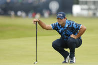 United States' Patrick Reed looks at the line of his putt on the 1st green during the first round British Open Golf Championship at Royal St George's golf course Sandwich, England, Thursday, July 15, 2021. (AP Photo/Peter Morrison)