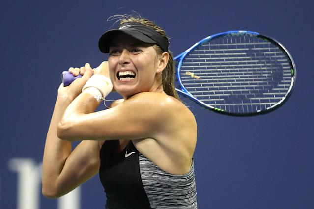 "Maria Sharapova fell to <a class=""link rapid-noclick-resp"" href=""/olympics/rio-2016/a/1195090/"" data-ylk=""slk:Carla Suarez Navarro"">Carla Suarez Navarro</a> on Monday night, losing her first night match at the U.S. Open. (Getty Images)"