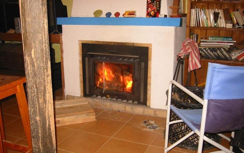 A fireplace inside one of the houses