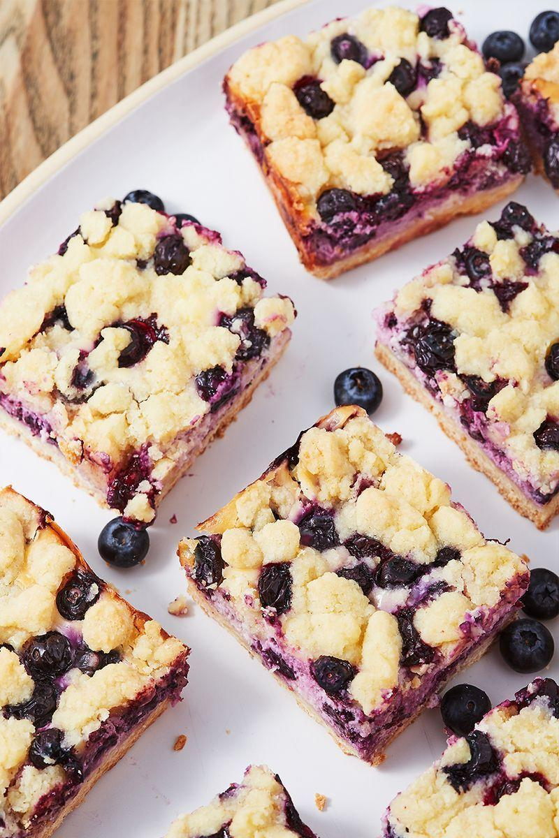 """<p>Lemons and blueberries go together like spring and sunshine. They are the perfect combo and these bars are our favourite yet! And if you like these, you'll obsess over our <a href=""""https://www.delish.com/uk/cooking/recipes/a32298682/lemon-blueberry-mini-cheesecakes-recipe/"""" rel=""""nofollow noopener"""" target=""""_blank"""" data-ylk=""""slk:Lemon-Blueberry Mini Cheesecakes"""" class=""""link rapid-noclick-resp"""">Lemon-Blueberry Mini Cheesecakes</a>.</p><p>Get the <a href=""""https://www.delish.com/uk/cooking/recipes/a32739672/blueberry-lemon-pie-bars-recipe/"""" rel=""""nofollow noopener"""" target=""""_blank"""" data-ylk=""""slk:Blueberry Lemon Pie Bars"""" class=""""link rapid-noclick-resp"""">Blueberry Lemon Pie Bars</a> recipe.</p>"""