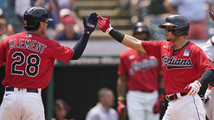Cleveland Indians' Cesar Hernandez, right, celebrates with Ernie Clement after Hernandez hit a two-run home run in the third inning of a baseball game against the St. Louis Cardinals, Wednesday, July 28, 2021, in Cleveland. (AP Photo/Tony Dejak)