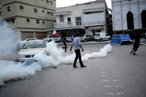 Bahraini Shiite Muslim protesters maneuver past tear gas as they clash with police during a protest in Bilad al-Qadeema, a suburb of the capital Manama. Bahrain's controversial Grand Prix race went off without incident on Sunday after a week of angry protests away from the F1 desert circuit that put the non-sporting focus on reform demands in the Gulf state