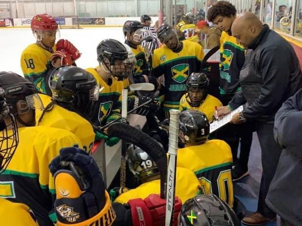 Head coach Cyril Bollers draws up a play during a timeout for the Jamaican men's hockey team. (Submitted by Cyril Bollers - image credit)