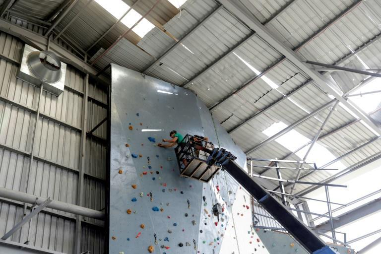 Volunteers at Beirut's Flyp centre, which was damaged by the port blast, have unscrewed climbing wall grips to move to a new venue