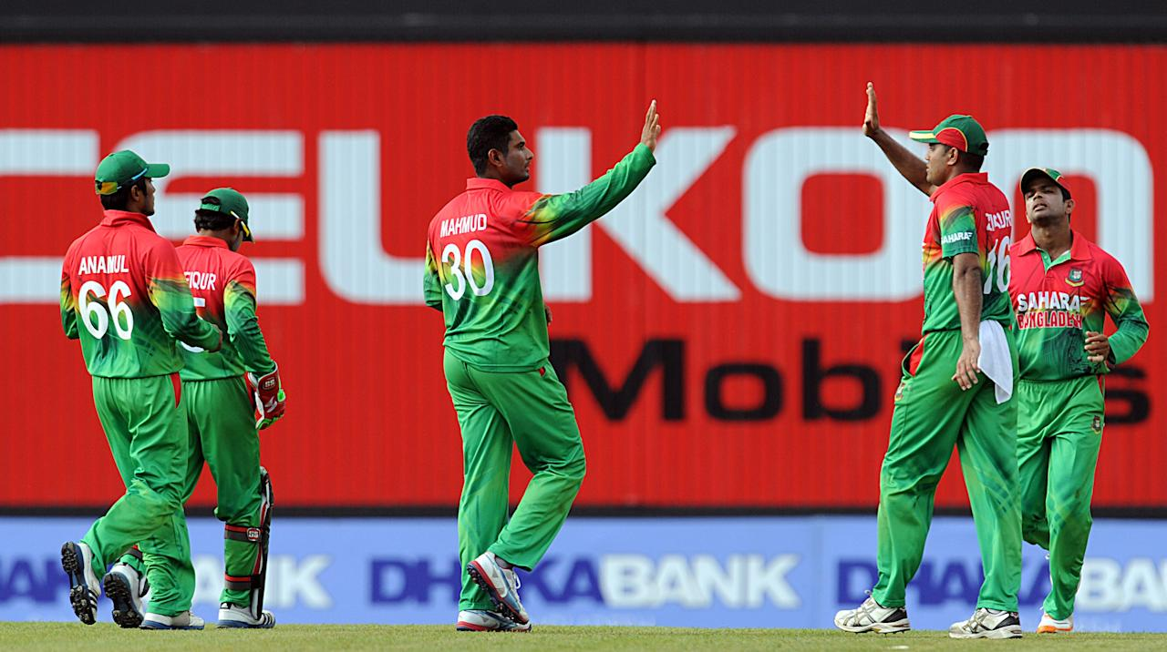 Bangladeshi cricketer Sohag Gazi (C) celebrates after he dismissed Sri Lankan cricketer Kushal Janith Perera during the third and final one-day international (ODI) match between Sri Lanka and Bangladesh at The  Pallekele International Cricket Stadium in Pallekele on March 28, 2013. AFP PHOTO/ Ishara S. KODIKARA        (Photo credit should read Ishara S.KODIKARA/AFP/Getty Images)