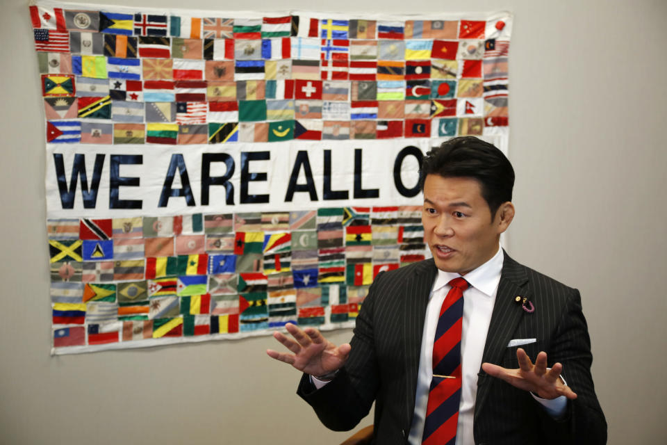 Japanese legislator Genki Sudo speaks during an interview with the Associated Press in Tokyo on Nov. 4, 2020. Sudo, a former mixed martial artist, wrestler and kickboxer, argues that the Olympics won't be fair to the athletes. Some can practice, but many can't because of the pandemic.(AP Photo/Koji Ueda)