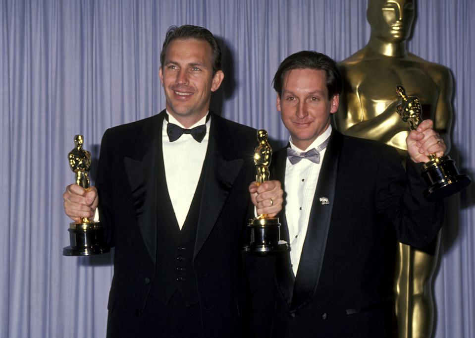 """Kevin Costner and Jim Wilson, winners Best Picture for """"Dances with Wolves"""" (Photo by Ron Galella/Ron Galella Collection via Getty Images)"""