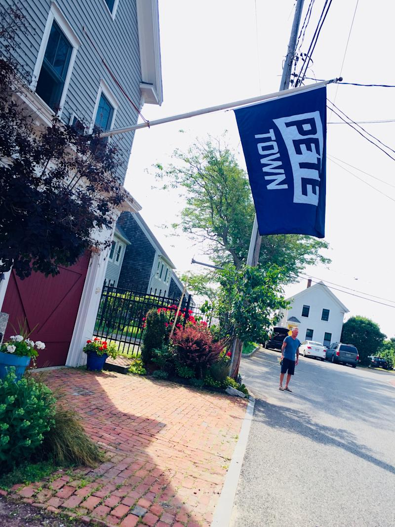 """A flag in Provincetown, Mass., makes a play on the nickname """"Ptown"""" in honor of presidential candidate Pete Buttigieg's visit on Friday. (Photo: Lula Greenfield-Herold)"""