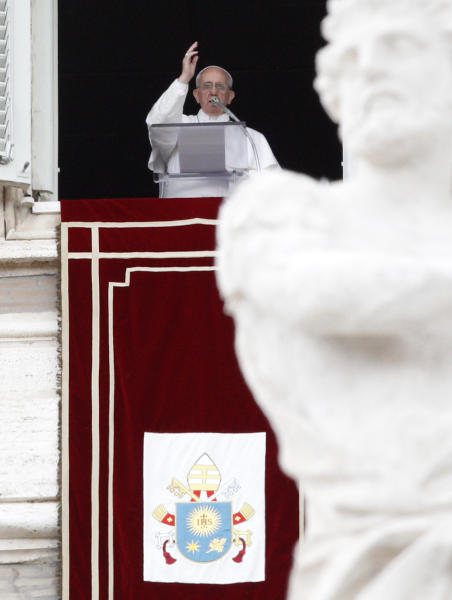 Pope Francis speaks during the Angelus prayer from his studio window overlooking St. Peter's square at the Vatican, Sunday, May 26, 2013. Pope Francis has hailed a priest murdered by the Sicilian Mafia and urged mobsters to stop exploiting people in criminal rackets including prostitution. The pontiff exhorted Mafiosi to change their ways, issuing the call Sunday, a day after the beatification of an Italian priest in Palermo who was slain in 1993 by mobsters after he defiantly preached against the Mafia in a neighborhood where Cosa Nostra held sway. Francis told a crowd in St. Peter's Square the Mafia killed the Rev. Giuseppe Puglisi because he tried to keep youths from being recruited by mobsters. He said it pains him when he thinks of all the people exploited by organized crime. (AP Photo/Riccardo De Luca)