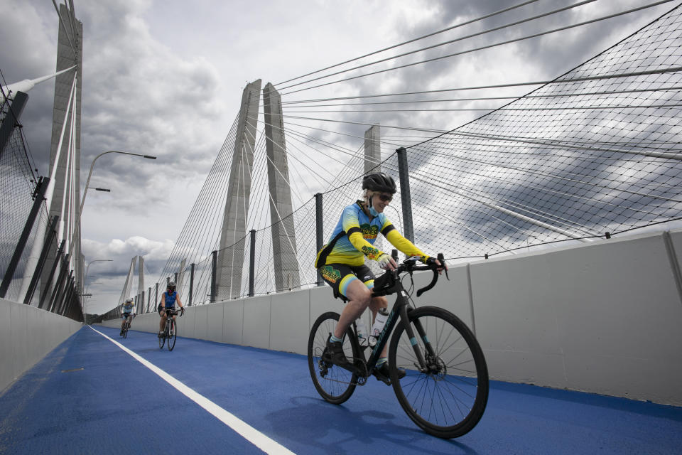Christine Schopen, president of the Westchester Cycle Club, takes a ride across the Gov. Mario M. Cuomo Bridge bike and pedestrian path on its opening day, Monday, June 15, 2020 in Tarrytown, N.Y. The new 3.6 mile path runs from Tarrytown across the Hudson River to South Nyack, N.Y. (AP Photo/Mark Lennihan)