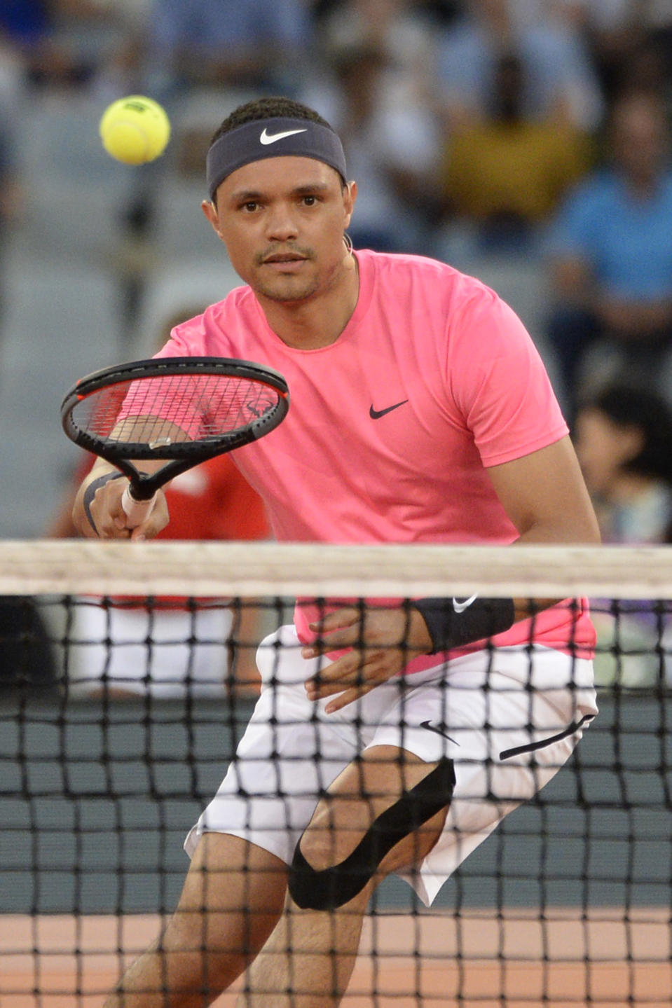 Here seen playing in February 2020 charity event The Match with Roger Federer, Rafael Nadal, and Bill Gates, Trevor Noah will soon test his video game skills for Quibi's 'Player vs. Player.'