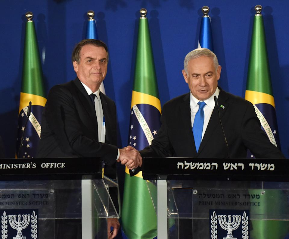 Brazilian President Jair Bolsonaro (L) and Israeli Prime Minister Benjamin Netanyahu shake hands during a joint press conference at the prime minister's residence in Jerusalem on March 31, 2019. - Brazilian President Jair Bolsonaro arrived in Israel today just ahead of the country's polls in which his ally Prime Minister Benjamin Netanyahu faces a tough re-election fight. (Photo by DEBBIE HILL / POOL / AFP)        (Photo credit should read DEBBIE HILL/AFP via Getty Images)