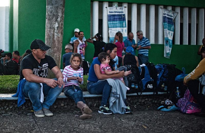 A group of Cuban migrants wait at the National Institute of Migrations in Tapachula, Chiapas state, Mexico on November 3, 2015 (AFP Photo/Pep Companys)