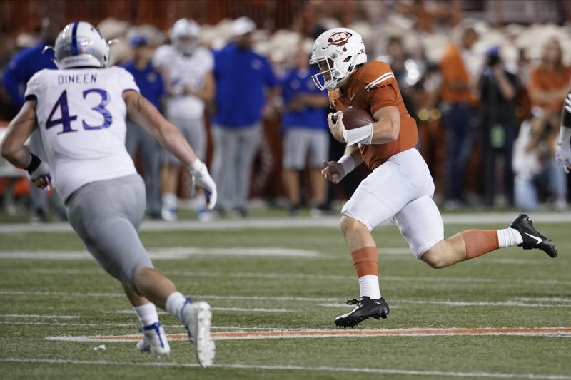 Texas' Sam Ehlinger (11) scrambles during the first half of an NCAA college football game against Kansas in Austin, Texas, Saturday, Oct. 19, 2019. (AP Photo/Chuck Burton)