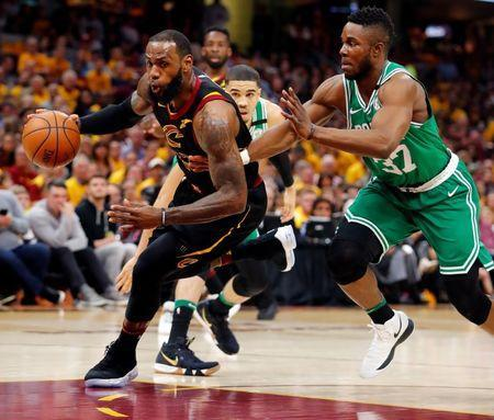 May 19, 2018; Cleveland, OH, USA; Cleveland Cavaliers forward LeBron James (23) drives to the basket in front of Boston Celtics forward Semi Ojeleye (37) during the first half in game three of the Eastern conference finals of the 2018 NBA Playoffs at Quicken Loans Arena. Mandatory Credit: Rick Osentoski-USA TODAY Sports