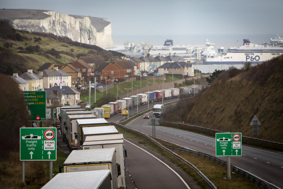 Lorries line up on the M20 motorway to use the BREXIT Dover Tap contraflow system into the Eastern Dock of the Port of Dover where the cross channel port is situated with ferries departing here to go to Calais in France on the 18th December 2020, Dover, Kent, United Kingdom. Photo: Andrew Aitchison / In pictures via Getty Images