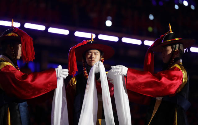<p>Performers fold the Olympic flag during the closing ceremony of the 2018 Winter Olympics in Pyeongchang, South Korea, Sunday, Feb. 25, 2018. (AP Photo/Kirsty Wigglesworth) </p>