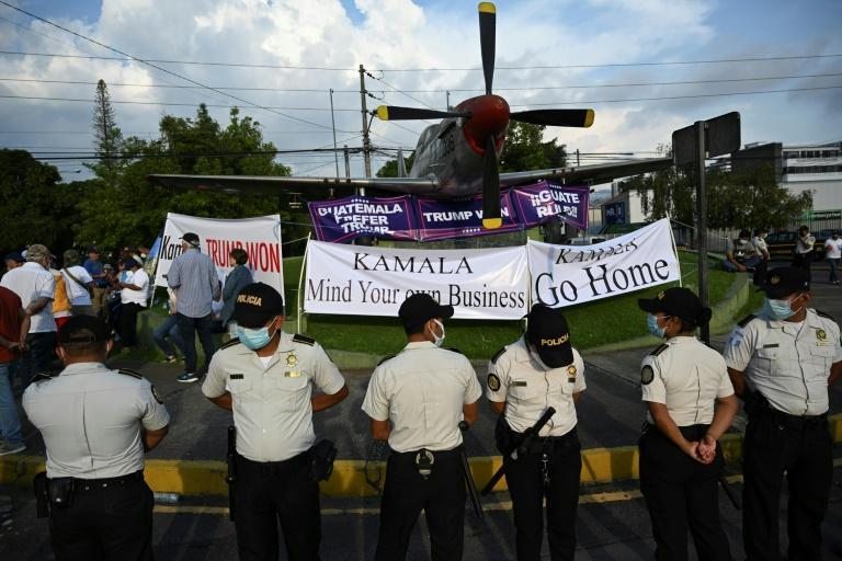 People take part in a demonstration against Harris' visit to Guatemala City