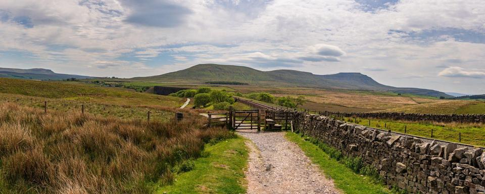 "<p>Located against the awe-inspiring backdrop of Ingleborough, Ingleton in the Yorkshire Dales is surrounded by marvellous <a href=""https://www.countryliving.com/uk/wildlife/countryside/a35191740/moving-to-countryside-advice/"" rel=""nofollow noopener"" target=""_blank"" data-ylk=""slk:countryside"" class=""link rapid-noclick-resp"">countryside</a> and stellar views. </p>"