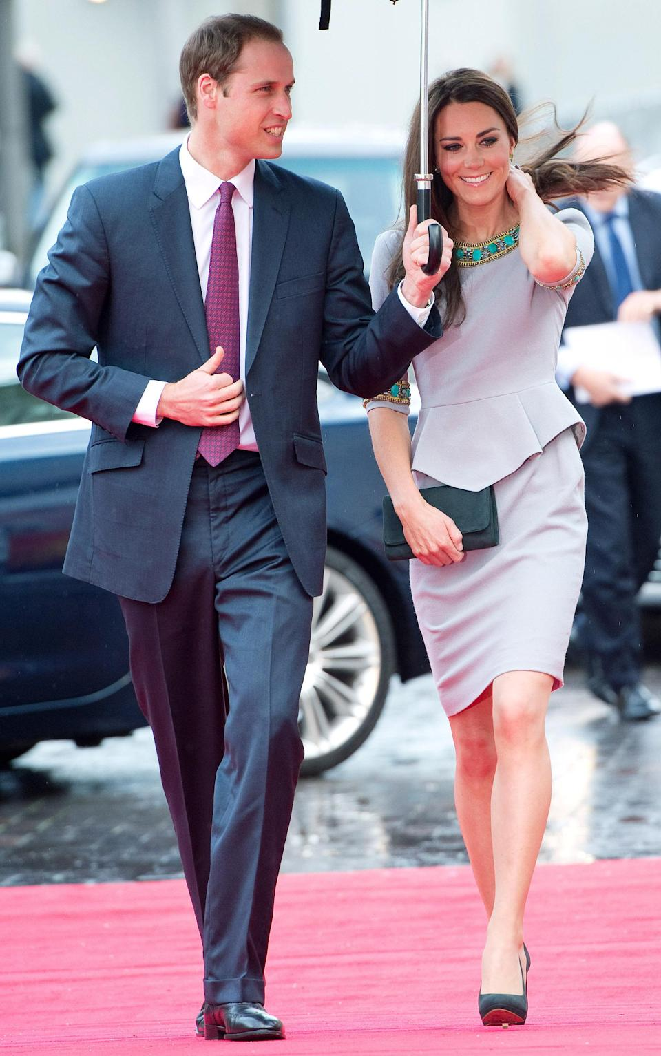<p>The Duchess of Cambridge wore a Mathew Williamson dress for the event while Prince William wore a navy suit and co-ordinating tie. <em>[Photo: Getty]</em> </p>